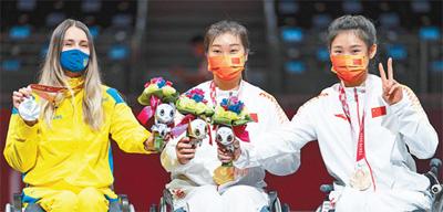 首个比赛日勇夺5金1银2铜,中国选手—— 比出水平 赛出友情(残奥会特别报道)