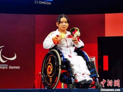 对话|残奥冠军郭玲玲:21岁练举重 体育让她再不自卑