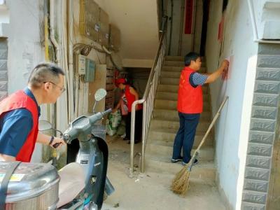 """迎国庆""""爱护环境卫生,创建清洁家园""""环境卫生整治活动"""